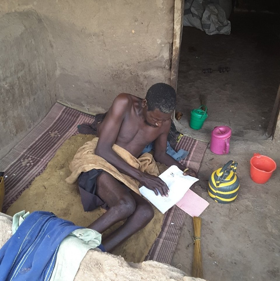 Gorogu reading his literacy book